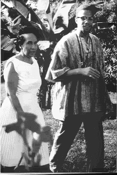 Malcolm X and Shirley Graham DuBois, wife of W.E.B. DuBois and Director of Ghana National Television, at her villa in Accra, Ghana during Malcolm's visit in May 1964. DuBois had thrown a reception in his honor.