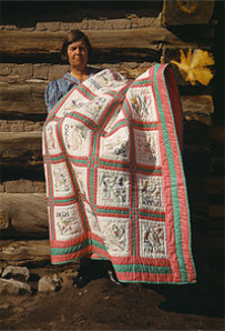 Woman holding African American Quilt from 1700s