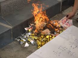 Chinese burning money for the dead.