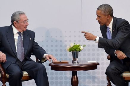 US President Barack Obama (R) speaks with Cuba's President Raul Castro (L) on the sidelines of the Summit of the Americas at the ATLAPA Convention center on April 11, 2015 in Panama City. AFP PHOTO/MANDEL NGAN (Photo credit should read MANDEL NGAN/AFP/Getty Images)